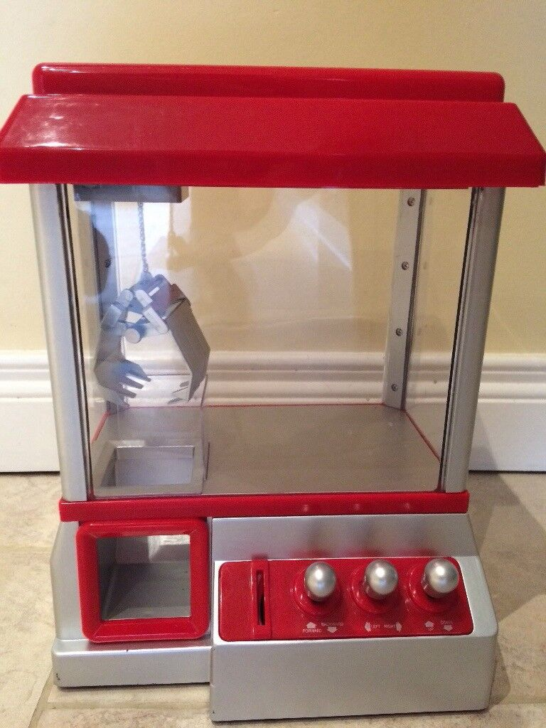 Toy grabber machine coin operated.