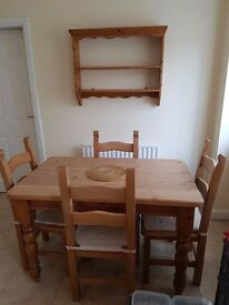 Farmhouse Kitchen Table with four ladder back chairs and matching wall rack