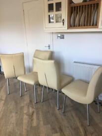 Cream Italian leather chairs