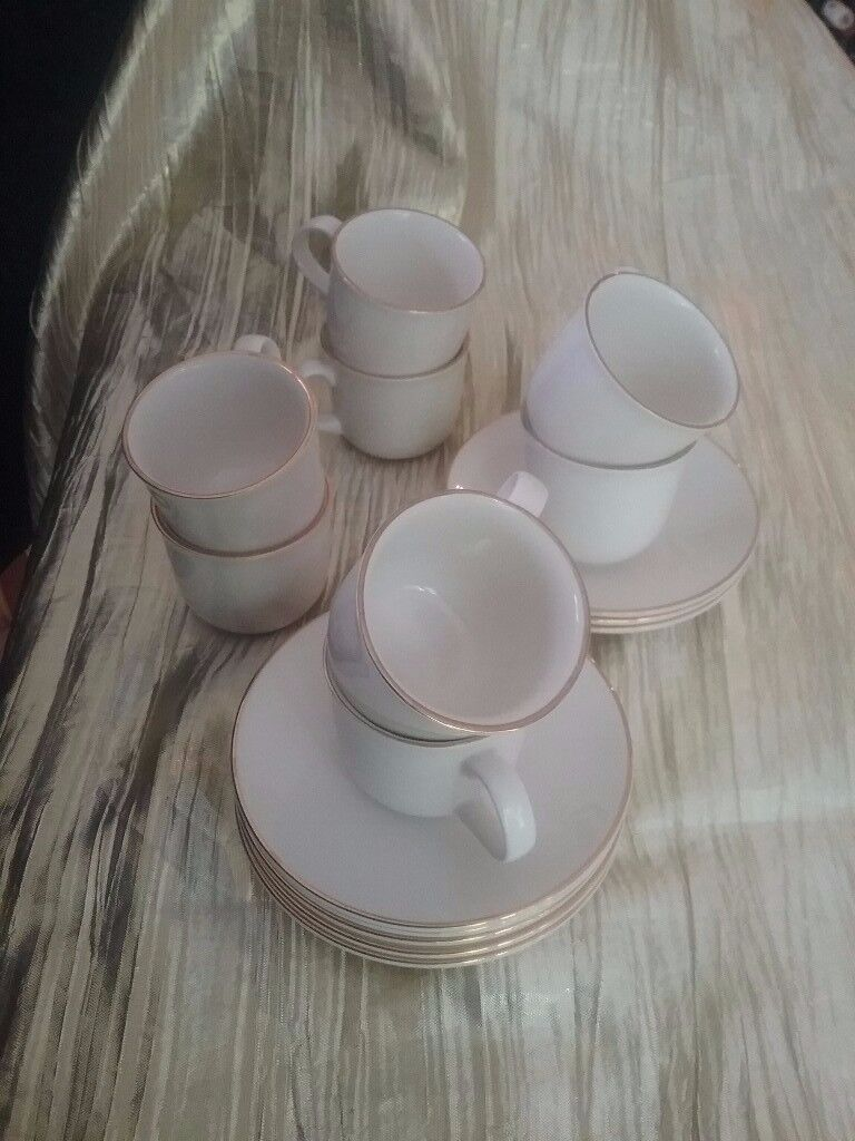 As new 8 espresso cups and saucers. Cream with gold trim