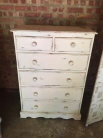 Large white chest of drawers.