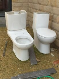 2 toilets. Used. No longer needed.