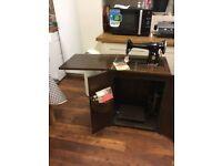 Singer treadle sewing machine in cupboard