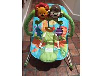 Baby Bouncer (colourful with animals design) with strings to pull for music and sound- £4