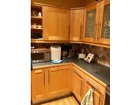 Wood Kitchen cupboards and Appliances.