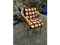 Small wicker chair with crochet cushions