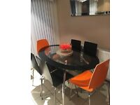 Glass oval table and 6 chairs