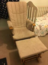 Gliding and reclining nursing chair with matching footstool.