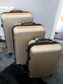 New 3 piece lite weight gold luggage