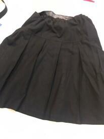M&S Girls black pleat skirt 2 pack