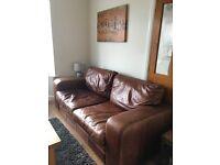 Tan/brown distressed vintage look sofa and chair