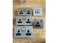 Brushed steel electrical sockets