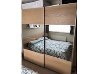 Pair of IKEA AULI/ILSENG sliding wardrobe doors in white stained oak veneer with 4 mirrored panels