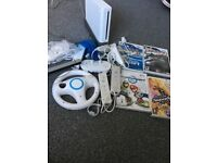 Wii console plus games and remotes