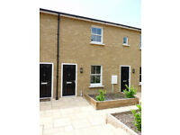 Two bedroom mid terrace mews property in a gated development in Gravesend with parking space