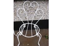 4 french wrought iron garden chairs.