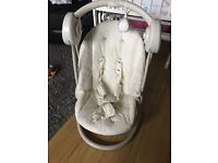 Baby's battery operated musical swing (Mamas&Papas)