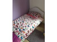 Single white wooden bed incl. mattress