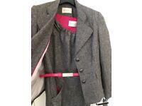 Grey/pink suit.