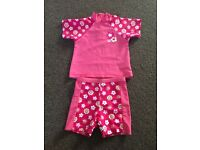 Girls pink sun suit 9-12 months
