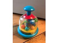 Push down spinning ball toy
