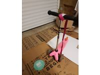 Micro mini scooter in pink. Used but excellent condition with pull along strap