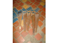 4 ANTIQUE WOODEN HANDLE SAWS + 1 ANTIQUE BLACK RESIN HANDLE SAW
