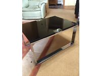 Contemporary Black glass coffee table with metal legs
