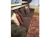 Charcole grey 4 seater sofas two matching footstools , only 6 months old. Immaculate condition