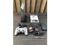 PlayStation 2 slim console with gran tourism 4 game. Ps2