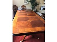 Beautiful Extending table and 8 chairs