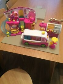 Large collection of shopkins including the bakery, ice cream truck and the boutique house.