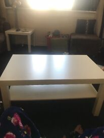 2 white coffee tables