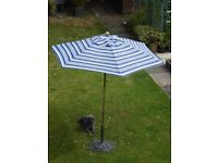2 Metre Parasol constructed from Hardwood, complete with a heavy Cast Iron base.