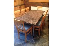 Large granite topped kitchen table by Durr Furniture