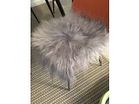 Grey fur seatpads for dining chairs