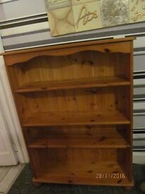SOLID PINE BOOK CASE IN VERY GOOD CONDITION MEASURES 30 IN . WIDE X 11 IN. DEEP X 48 INCHES HIG