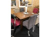 Never used dark wood extending table and six buttoned chairs(mix color)