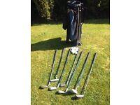 Junior golf clubs, bag, balls, glove