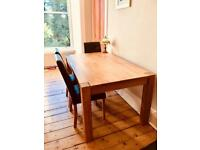 Solid oak wood table and four chairs