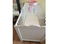 White wooden cot with mattress