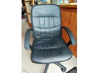 Black faux leather swivel and height adjustable office chair