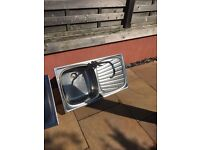 Stainless steel kitchen sink including tap