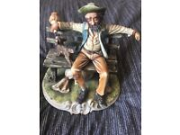 Capodimonte figurine of old tramp on bench. Nice condition