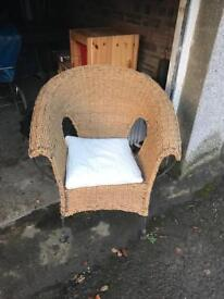 Wicker chair with iron legs