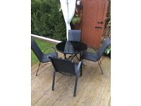 Garden round table and 4 chairs and parasol black excellent condition