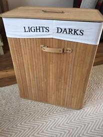 Darks and lights bamboo style laundry basket.