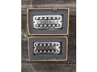 A PAIR OF GRETSCH FILTERTRON NICKEL PLATED GUITAR PICKUPS