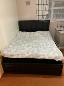 Black leather double ottoman bed