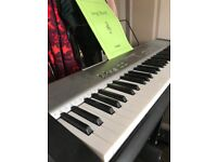 Casio keyboard and stand, excellent condition. Offers!